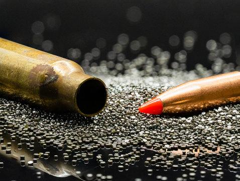 .223 5.56 caliber bullet, casing and gun powder close-up.