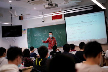 Teacher teaches inside a classroom at a high school in Shanghai