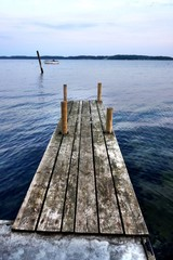 Old Wooden Pier On Lake