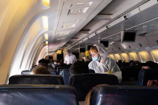 MIAMI, USA - APRIL 26, 2020: Covid 19 coronaviruse. Stewardess in protective mask on the plane board. Evacuation repatriation. Flying during coronaviruse pandemic. Special flight returns US citizens.
