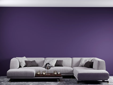 3d render. Living room with a large sofa and pillows. The purple wall is an accent. Interesting decor and glass candle holders. Large soft graphite carpet
