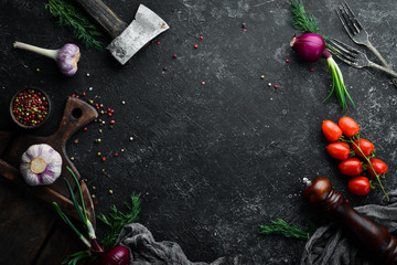 Fototapete - Black kitchen banner: vegetables and spices on a black stone background. Top view.