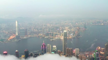 Fototapete - Aerial time lapse of Victoria Harbour, Hong Kong, at evening, cloudy day, cityscape