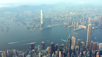 Fototapete - Aerial view of Victoria Harbour, Famous metropolis city, Hong Kong, at evening, cloudy day, Cityscape