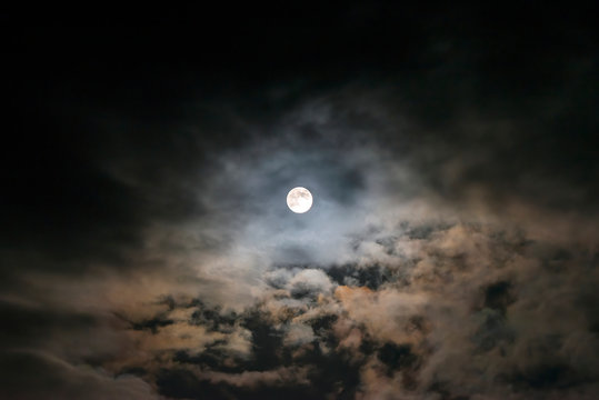 The Flower Moon shining bright in the cloudy sky, 7/5/2020 , Cornwall, UK