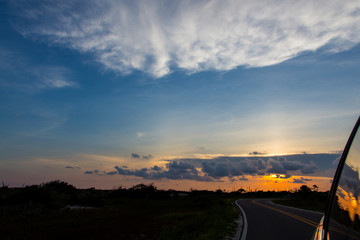 Foto auf Gartenposter Dunkelgrau Country Road Along Silhouette Landscape