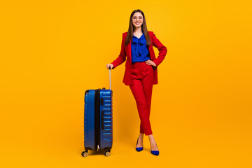 Fototapete - Full length photo of classy pretty business lady wait airport flight registration hold rolling case wear specs red luxury blazer blouse pants suit shoes isolated yellow color background