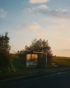 Bus stop at sunset