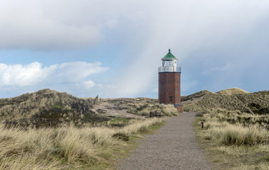 Lighthouse on the Red Reef on the island of Sylt near Kampen Fototapete