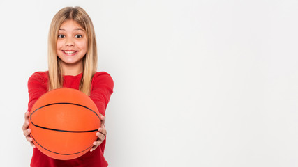 Portrait girl with basketball copy space isolated in white background