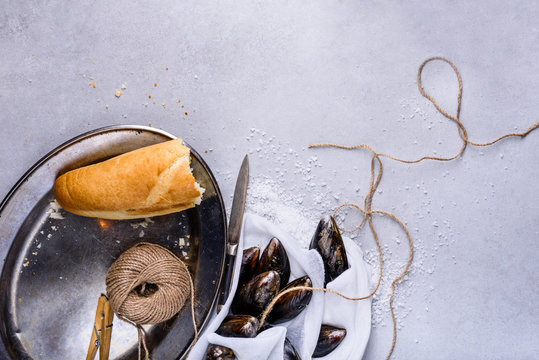 Mussels or clams, shellfish on light background, text space. Overhead view.
