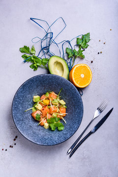 Poke bowl with Salmon and avocado. Clean eating.  Seafood salad recipe. Top view, copy space.