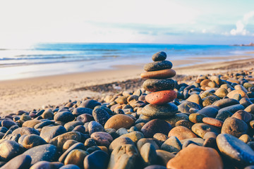 Close up of rocks stacked one on top of another with soft selective focus. Stones are naturally balanced on the background of the sea. High-quality free stock images of rocks and landscapes