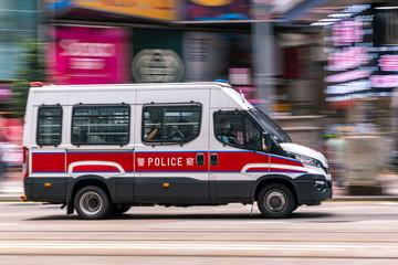 Fotomurales - Casueway Bay, Hong Kong  - May 01, 2020 : Police car travel at business district of Hong Kong