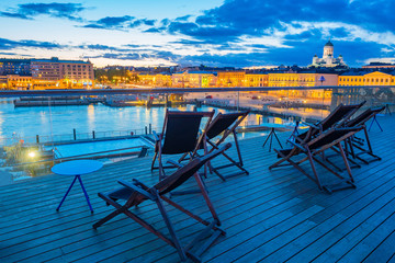Evening in Helsinki. Finland. Recreation area in the Harbor of the Finnish capital. Street cafe with a view of the cruise port. Outdoor pools in Helsinki. Travel to Scandinavia.