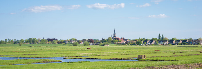 Panoramic view of a classic polder landscape and the village of Reeuwijk-dorp in the western part of the Netherlands