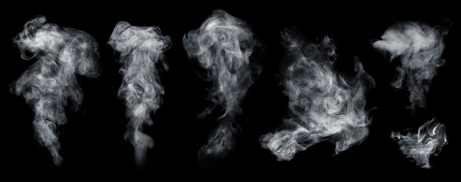 Fog or smoke set isolated on black background. White cloudiness, smoke, mist or smog background.