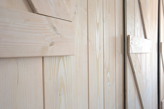 Light wood barn doors background texture modern interior close-up