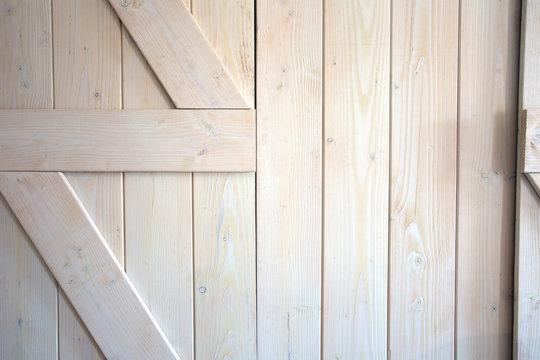 Light wood barn doors background texture modern interior close-up