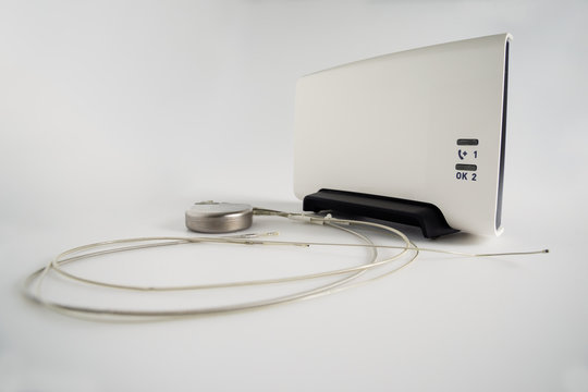 An Implantable Cardioverter Defibrillator or ICD pacemaker with leads and modem for telemonitoring at home. The device sends data to the hospital on a regular basis.