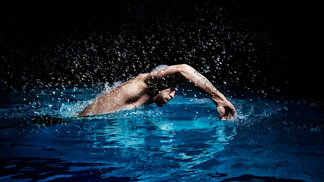 Man crawls. Water sports concept.