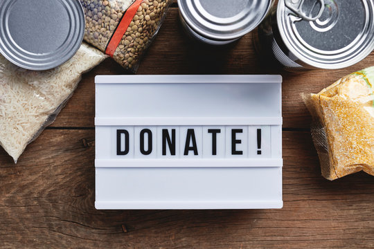 a donate sign surrounded by food items