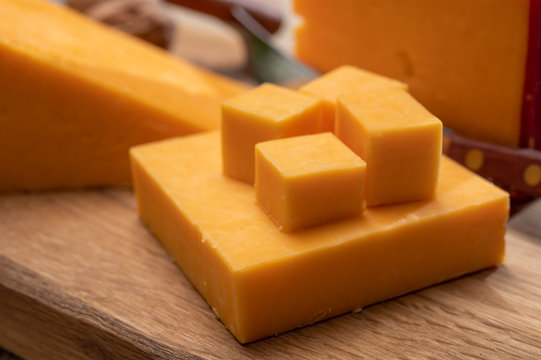 Red waxed yellow cheddar cheese close up