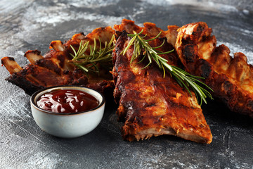Grilled spare ribs for a tasty bbq meat with hot spicy barbecue sauce