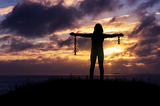 Break free from the chains, Woman with broken chains.