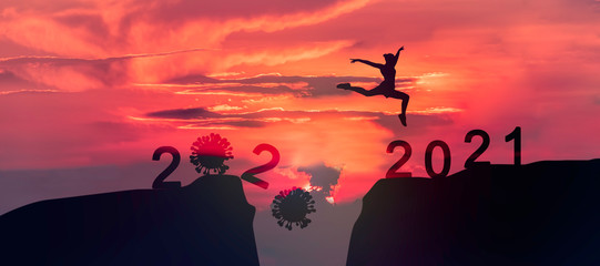 Tuinposter Koraal Young woman Jumping across the gap of the mountain from 2020 to 2021 New Year.