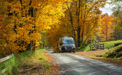 Autumn leaves on country road near Woodstock Vermont - RV