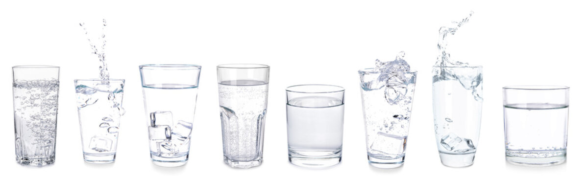Many glasses of fresh water on white background