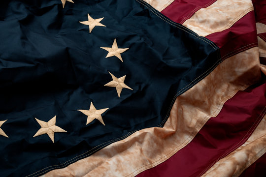 Revolutionary war, patriotism and birth of the United Sates of America concept with closeup on the original 13 star American flag known as the Betsy Ross