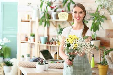 Obraz Portrait of female florist in shop - fototapety do salonu