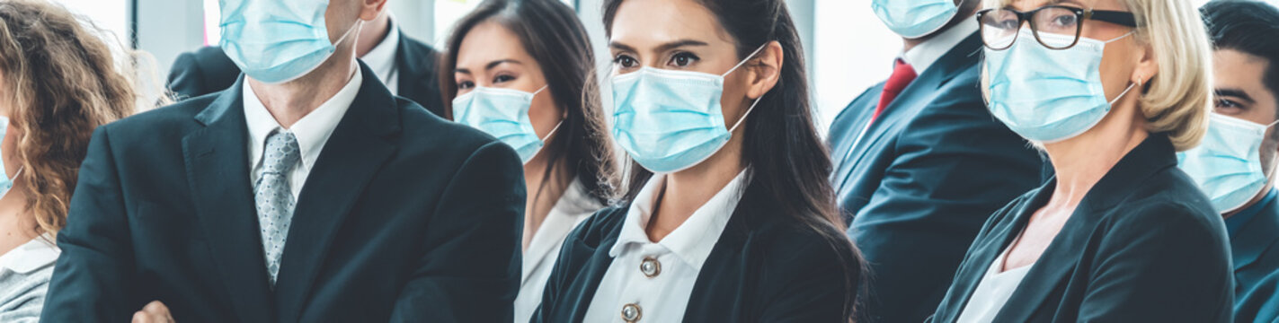 Confident business people with face mask protect from Coronavirus or COVID-19. Concept of help, support and collaboration together to overcome epidemic of Coronavirus or COVID-19 to reopen business.