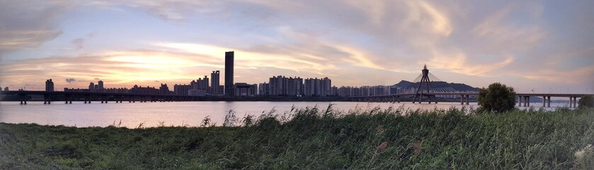 Panoramic View Of City Against Cloudy Sky During Sunset