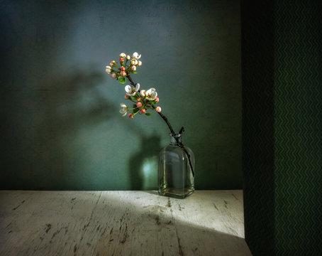 Still life with a flowering branch. Spring, Interior. Minimalism.