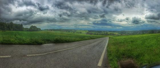 Foto auf AluDibond Dunkelgrau Empty Road Along Countryside Landscape