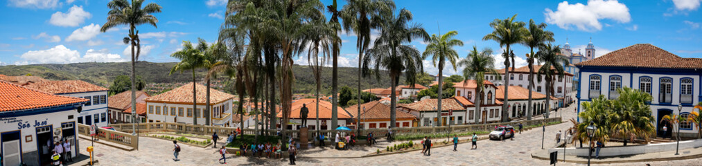 Panorama of traditional houses and palm tree lined street in historic center of Diamantina on a sunny day, Minas Gerais, Brazil