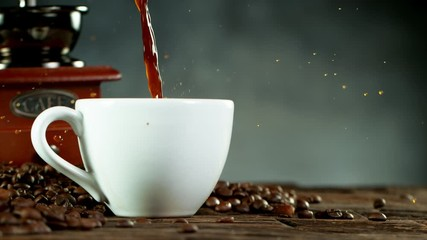 Fototapete - Super slow motion of pouring coffee into cup with copy space. Filmed on high speed cinema camera, 1000fps
