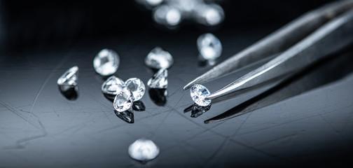 Small Diamonds on dark background (close up shot; selective focus)