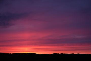 Foto auf Gartenposter Aubergine lila Scenic View Of Dramatic Sky Over Silhouette Landscape
