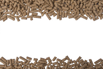 Granules of animal feed close up. Background texture isolated