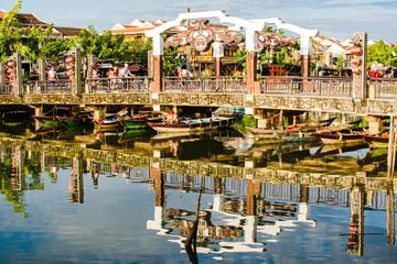 old bridge, river and boat in hoian vietnam Fotomurales