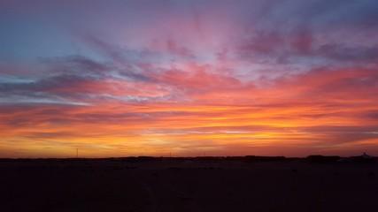 Foto auf Gartenposter Koralle Scenic View Of Landscape Against Sky During Sunset