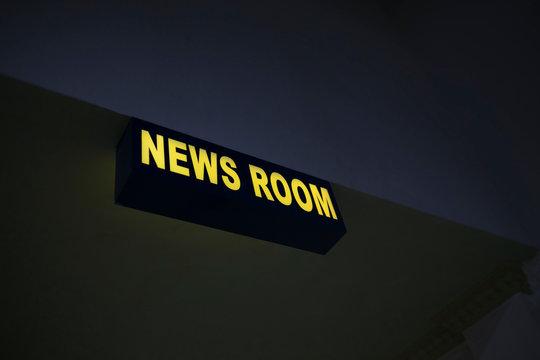 News room light board on the wall