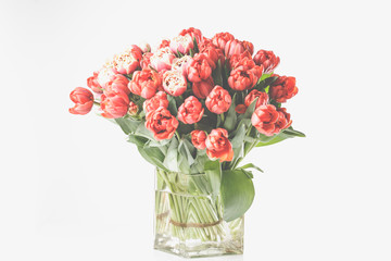 A large tulip bouquet, many flowers with red blossoms.