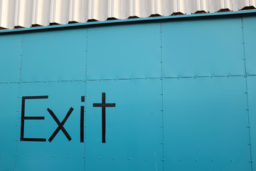 Word 'Exit' on facade of a storage