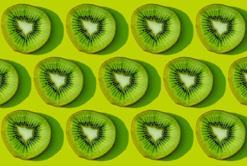 Kiwi fruit pattern on green background