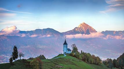 Slovenia, Church of St Primoz near Jamnik at sunset